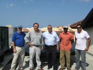 From left: FSEC researchers Bill Young and John Harrison, Facilities Manager of the Bucuti Hotel and Resort, FSEC researcher Patrick Robinson, and local PV entrepreneur Robert Mc David.