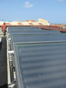 Patrick Robinson inspects integral collector-storage (ICS) solar hot water systems at a resort in Aruba.