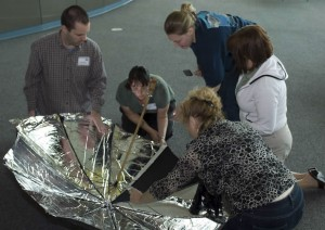 Teachers learn how to construct solar cookers from everyday items such as an umbrella.