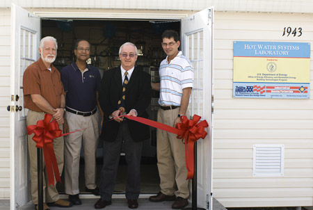 Mr. Robert Hassett, U.S. Department of Energy's Building America Solar Heating and Cooling Technology Manager, cuts the ribbon at the opening celebration of FSEC's new Hot Water Systems Laboratory. He's joined by (from left to right) Danny Parker, principal investigator, Subrato Chandra, project manager, and Carlos Colon, task leader.