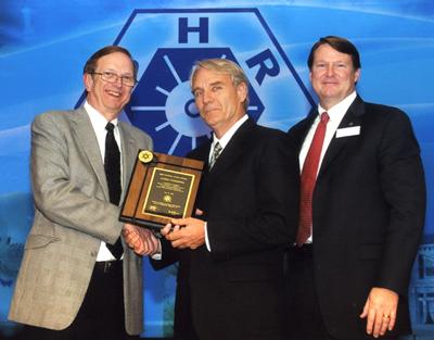 James Cummings accepts award at ASHRAE conference in June 2009.