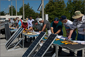 During a train-the-trainer event at the Florida Solar Energy Center, participants learn about solar technologies and developing training curricula.