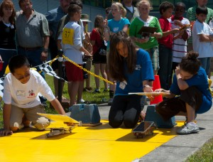 Which solar-powered car will make it to the end of the 30 meter track the fastest?