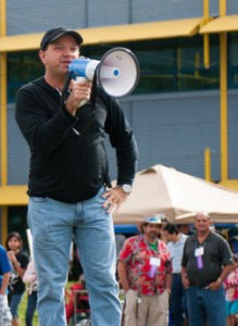 Cocoa Mayor Henry Parrish III speaks into megaphone.