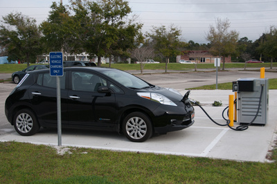 Photo of black Nissan Leaf being charged with DC fast charger.