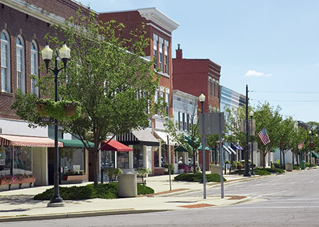 "Photo of small town businesses on a ""main street."""