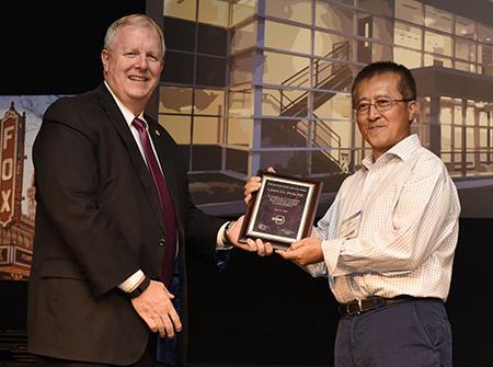 FSEC's Dr. Lixing Gu receives ASHRAE Distinguished Service award.