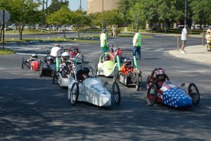 Photo of go-cart type electric vehicles ready to race at FSEC as part of EnergyWhiz.