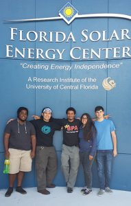 Students standing in front of Florida Solar Energy Center sign.