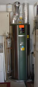Heat pump water heater inside laundry room of house, photo.